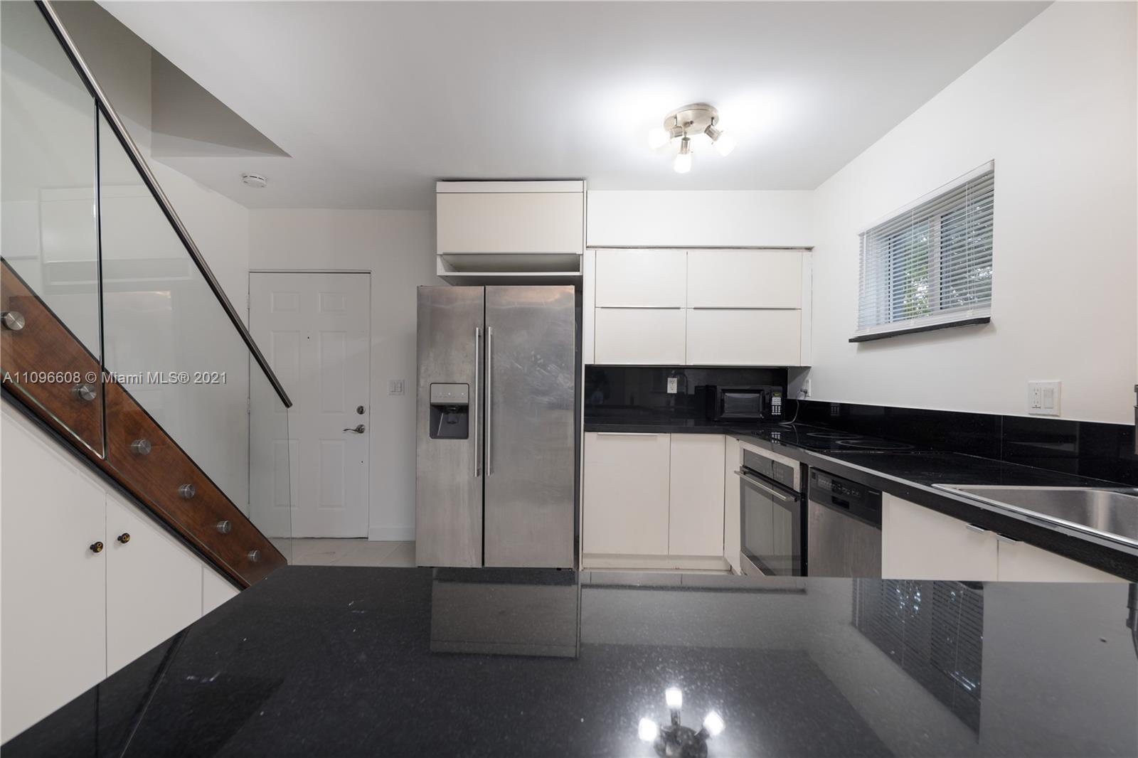 Completely updated 1 bedroom 2 story townhome located in the heart of Coconut Grove. This unit welcomes you with an open kitchen, modern tile floor, stainless steel appliances, dishwasher, garbage disposal, washer & dryer, 1/2 Bath, and spacious balcony. Enjoy the custom glass railings, custom wood stairs, and modern hanging chandelier. Both bedrooms located upstairs with balcony access each room. The fullpath separates both rooms and both closets within bedrooms offers custom california closets. Building offers hurricane impact windows & state of the art security cameras. Apartment has 1 assigned parking spot and also offers street parking for guests. Minutes away from Cocowalk, University of Miami, Coral Gables, Brickell, Sunset Mall and much more!