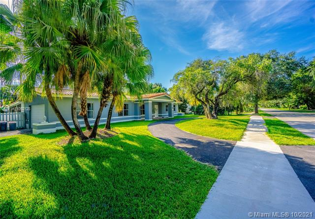 This home is perfectly located in North Pinecrest. This home sits on a 15,167 SF lot and 3,265 Sf living aera with a private garage for 2 cars and circular driveway for 3 cars. This beautiful home offers 4 bedrooms,3 bathrooms, spacious and open living space filled with natural light, and a large backyard. The architecturally detailed living room opens up to an incredible patio & the pool that blends naturally with the beautifully landscaped backyard—Grand family room with cheminee, expansive master suite with a large master bath. Desirable family home located on quiet street in a well-established community. Close to Pinecrest Elementary  School district.