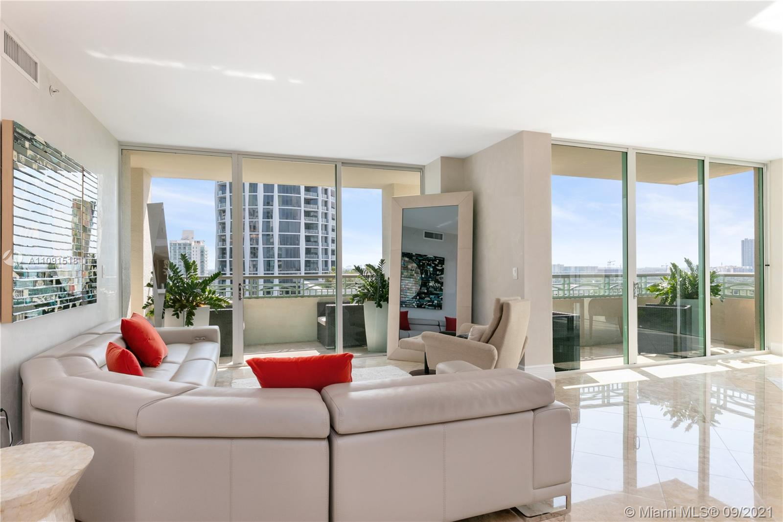 Large corner unit high-floor 2 bedroom plus den with 2.5 baths. Great views to Coconut Grove and downtown Coral Gables from every room. Partial water view. Foyer entry with marble flooring throughout. Huge kitchen. Media room/den enclosed and can be a 3rd bedroom (has a window and a door). Luxurious master bath with dual sinks, Jacuzzi tub and separate glass enclosed shower. Ritz-Carlton residences and hotel amenities and privileges.