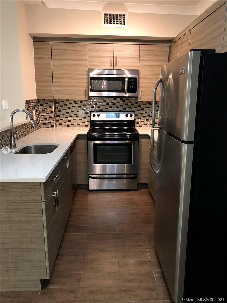 AVAILABLE 9/17 FOR SHOWING. Move-In Ready 1/1 in the heart of the City Beautiful! Beautifully updated kitchen featuring SS Appliances, white quartz countertops, contemporary cabinets & sleek tile back splash. Central AC, spacious closet, W/D in-unit! Modern ceramic wood-look tile, white crown molding, plenty of natural light! This is a top floor, corner unit - Lots of Privacy! No elevator in building. Bright white bathroom, linen closet for extra storage. Entire building has Hurricane Impact windows & doors + 24-Hr Video Surveillance. Street parking. 1 Pet allowed up to 35 lbs with pet fee. Rent covers water, sewer, trash removal, pest control. Please request showing via SHOWING ASSIST. Min credit 670. Text LA for any questions. Fridge + bathroom sink being replaced before new lease.
