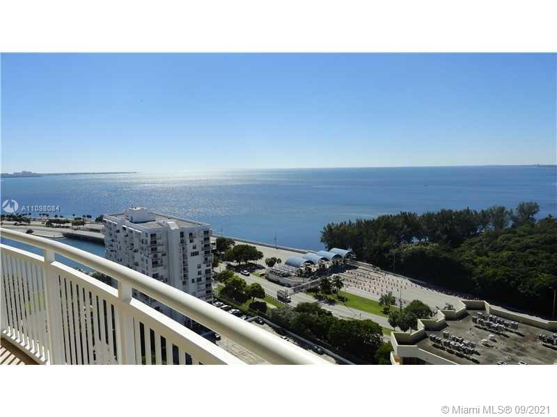 """Stunning unobstructed bay views from this completely redone 2 bedrooms 2 bathrooms corner unit split plan. See the Bay, Vizcaya and Key Biscayne from all the rooms. Unit completely remodeled, W/9""""ceiling's,new Italian Porcelain rectified tile flooring throughout, brand new kitchen with HE appliances, granite counter top, new lighting bathrooms with granite counters, custom wood cabinetry closets in kitchen and baths, Spacious walking closet. New Hunter-Douglas blinds throughout costing $5,000.Walls skim coated smoothed before painting. Storage#200,2 parking spaces ,403-402.Concierge 24 hs security, free valet parking, pool, sauna, Barbecue, Business Center, convenient store, playground, conference room, Bike Storage, Unit is rented until  July 9, 2022- NEW AC UNIT AND NEW WASHER AND DRYER"""