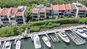 Spectacular waterfront 4 bedroom, 4 bath multi-level townhome in gated community of Royal Harbour Yacht Club. Marble floors and recessed lighting throughout. Walls of glass on every level provide serene water views. Gracious formal living and Dining rooms, Spacious kitchen with breakfast nook. Gorgeous master suite with views of Deering Bay and private balcony, walk-in closet, spacious bath. Roof top deck with wet bar and upper viewing deck, perfect for getting some sunshine or entertaining under the stars. Lots of storage areas, 1 car garage.  Amenities include access to beach and pool, tennis courts and security. All impact glass. Boat slip available separately.