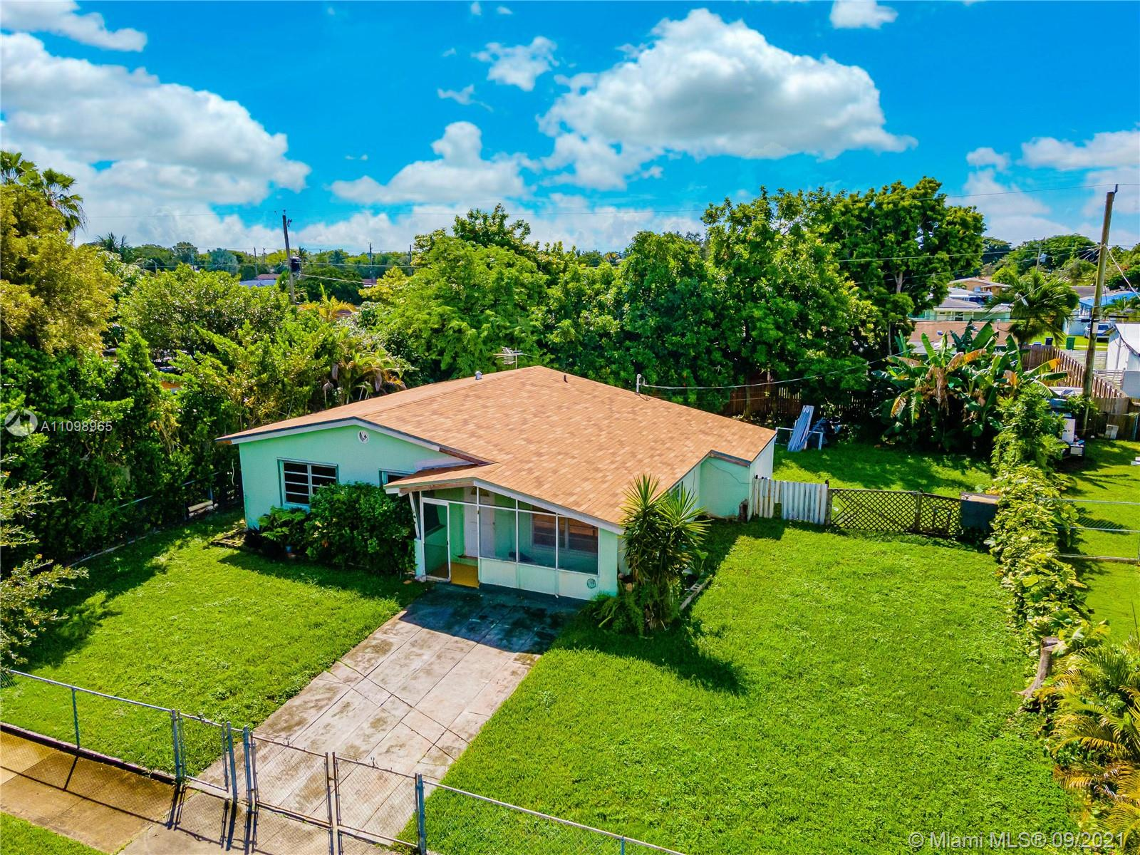 This beautiful Cozy 3 bedroom/1 bath in Cutler Bay, FL just got a new roof installed. Total area is 1435 sqft. The home features tile floors throughout and terrazzo floor in bedrooms. The den space is a bonus, it offers more room for customization. The back yard offers a tropical Island feel with large fruit trees including avacado, ackee tree and banana trees. You really might think your on a Caribbean Island somewhere. The Huge backyard and side yard is spacious enough for a pool/addition to the house, a boat or RV you name it. Located just minutes to shopping malls, restaurants, and highways. This home only awaits your imagination and a few touch ups  and personalized updates to make it your ideal Florida home a real tropical paradise.