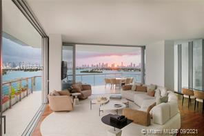 Composed of 59 individually designed waterfront residences around a glittering lagoon, Monad Terrace by Pritzker Winner, Jean Nouvel, provides brilliant light, private outdoor space, climbing gardens, unique sawtooth honeycomb facades & stunning sunset views of Biscayne Bay. Kitchens with dramatic sculptural marble island in Calacatta. Master baths with richly veined, spacious stone countertops, marquetry flooring and tiled walls. Other notable features include custom cabinetry & built-in features, designer fixtures, teak flooring throughout & private elevators. Immediate Occupancy. Photos and Renderings are from model residences.