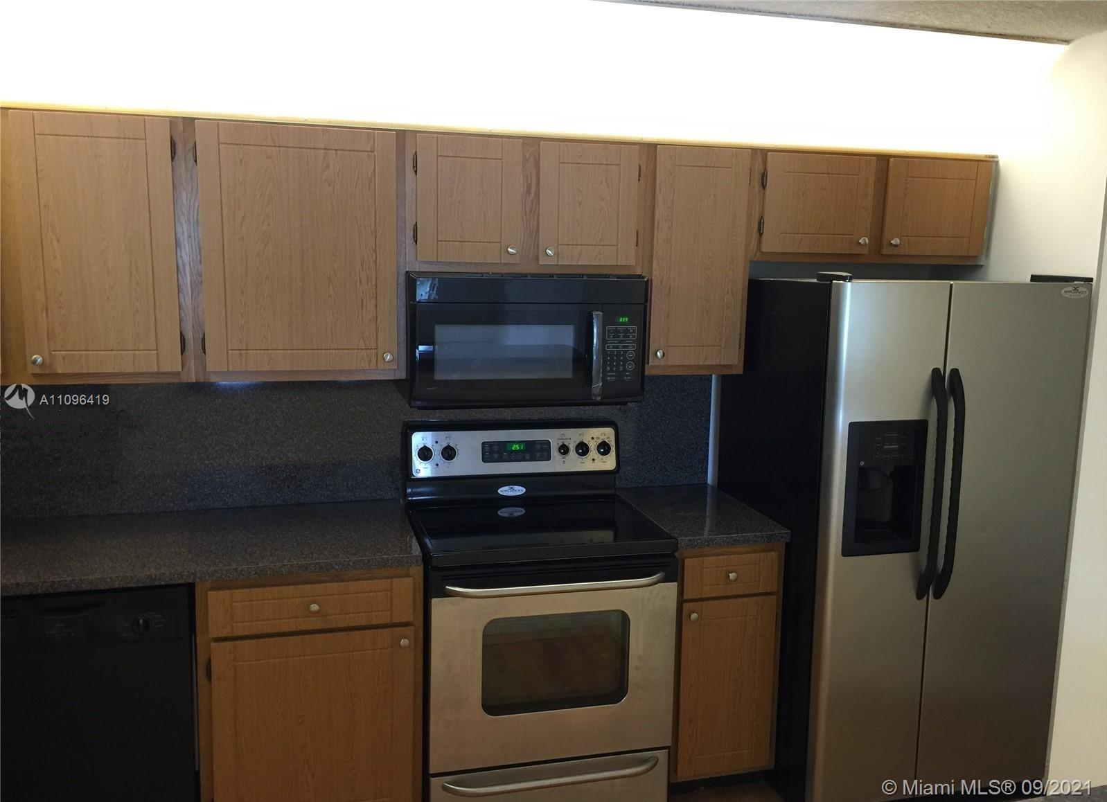 Attention Investors !!! Great ROI. 2 big bedrooms 2 bathrooms, walk-in closets, tile and wood floors, upgraded bathroom and kitchen, just painted and ready to move. Similar units renting now for $1400 low maintenance fee. Lake front condominium with security guard at entrance.