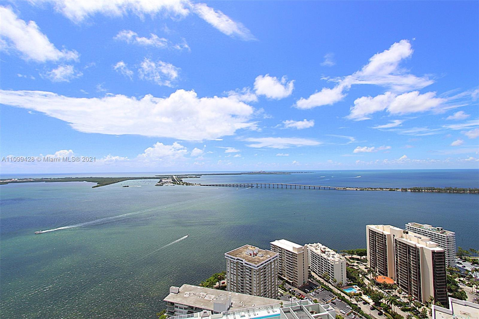 Sweeping & unobstructed water views from this 43rd floor penthouse located in the Brickell House Condo! Built in 2014, this magnificent high rise offers high end amenities which include 2 pools, gym, spa and valet service. Double main entry way foyer leads you to an ample and open main living area with floor to ceiling glass throughout. Water views can be had from almost all areas of this unit. Split floor plan provides a well-appointed master suite including enormous walk-in closet, master bathroom with soaking tub, separate shower and double sink vanity. Maids quarter next to laundry area. Balcony spans the complete length of unit with access points from all rooms. This is a one of a kind unit not to be missed!