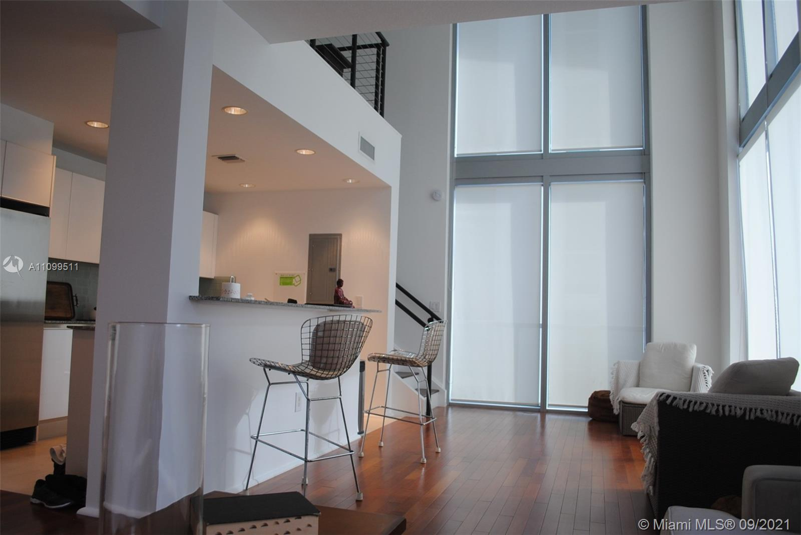 Beautiful furnished duplex loft corner unit + den with lots of light. 1200 Sq. Ft. Very few units like this one! Full spacious bathroom upstairs with two sinks plus half bathroom downstairs. Brazilian cherry wood floors throughout + marble in the kitchen. One valet parking included. Unit in impeccable condition. Very competitive price per sq. ft. Great building amenities and great location. Basic cable included as provided by the association! Walking distance to restaurants, shops and entertaining! A must see! Easy to show. Sorry no pets.