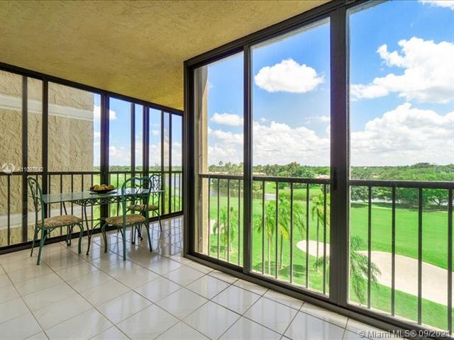 Amazing panoramic view of the golf course and lake from this spacious 2 bedroom 2.5 bathroom unit. Large enclosed balcony, large pantry with washer and dryer. Building has security 24/7, is very well maintained and already passed 40 year recertification. Enjoy all the amenities of Bonaventure Town Center Club, swimming poll, tennis court, fitness center and much more ( mandatory annual membership for the low fee of $285).  Great location, Weston is one  of the safest city, with A+ schools. Close to the restaurants, shops, malls, and the Highways I-75, I-595 and Sawgrass Express and Cleveland Clinic Florida. Enjoy living in a resort style, surrender by nature, in a quiet community.
