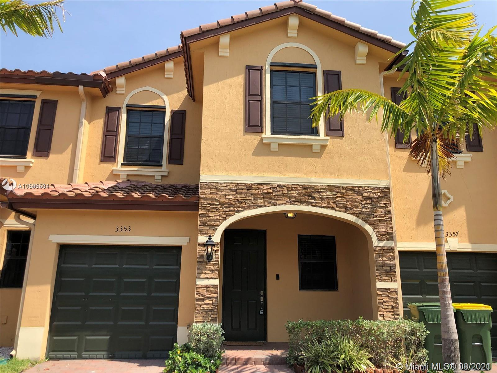 Beautiful large townhome with an open concept kitchen. The appliances are stainless steel and quartz counter tops, washer and dyer upstairs and tankless electric water heater Tile on the first floor and carpet on the second floor. Private backyard and 1 car garage space
