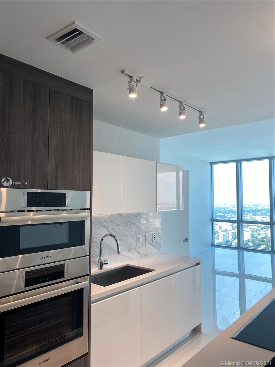 Live in Paramount Miami World Center and you'll never want to leave your home. Never lived-in, spacious one bedroom, plus den and two full baths, can be easily converted into a 2 beds. Elevator with private foyer. Custom built-out closet systems, window treatments and black-out rollers in the bedroom. Large dine-in terrace offering beautiful sunset hues. Top-of-the-line Bosch appliances, quartz countertops, Italian cabinetry, floor-to-ceiling impact glass sliding doors, pre-wired for cable/internet, porcelain flooring and marble bathroom floors, large separate washer/dryer and access to 5-star amenities, including: resident indoor/outdoor lounge, jam room, soccer field, SPA, state-of-the-art gym with boxing studio, theatre, kids pool, outdoor bath spas, basketball court and much more.