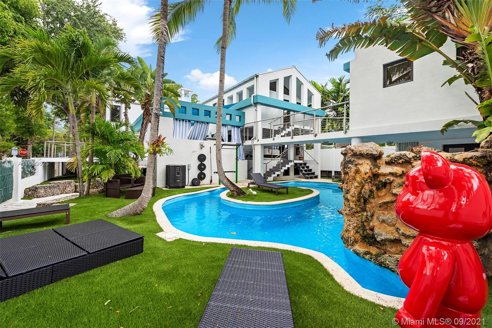 One of a kind Estate in the Heart of Coconut Grove. Ideally located on a beautiful corner lot tucked away on a quiet street close to the bay, downtown and Brickell. This ideal home is perfect for entertaining alfresco in the resort style setting back yard with summer kitchen and winding oasis pool. Main house offers 5 bedrooms 4 bathrooms with multiple entertaining areas and levels. Gorgeous new gourmet kitchen featuring designer appliances and quartz counter tops. Spacious Master suite with master bath offers a relaxing view of tree canopies. Detached guest cottage offers 2 levels with kitchenette.