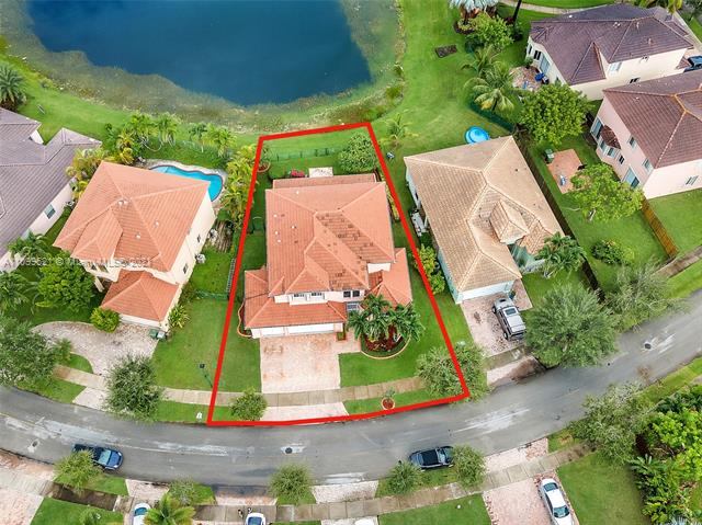 """Come See one of the largest 2 Story Estate Lakefront homes in Keys Landing. This home has 3,196 sq ft. of living space, with a sprawling 4 bedrooms 3.5 baths, upgraded kitchen with 42"""" cabinets & granite counter tops, laundry rm. with Kenmore Elite front loader washer/dryer & cabinets/drawers for plenty of storage options. Impact windows & sliding doors, Electric Rolladen shutters in Master/living rm. Extended Master suite with custom closet organizers. In-law/guest suite downstairs with a full bathroom. Covered terrace with 20' Wooden beams, outdoor kitchen, screened in front porch, Roof only 2 yrs. old with extra insulation, (water heater & garage doors also insulated). New LENOX 5 ton A/C unit. 3 car garage with plenty of cabinets, sink with running water. Come make this your new home!"""