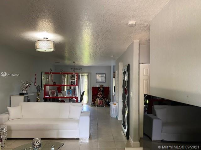 Amazing corner lot unit, fenced backyard, tiled throughout, assigned parking space and additional for guests  and much more.  Property currently has a tenant, lease expires June 2022 that has to be honored.