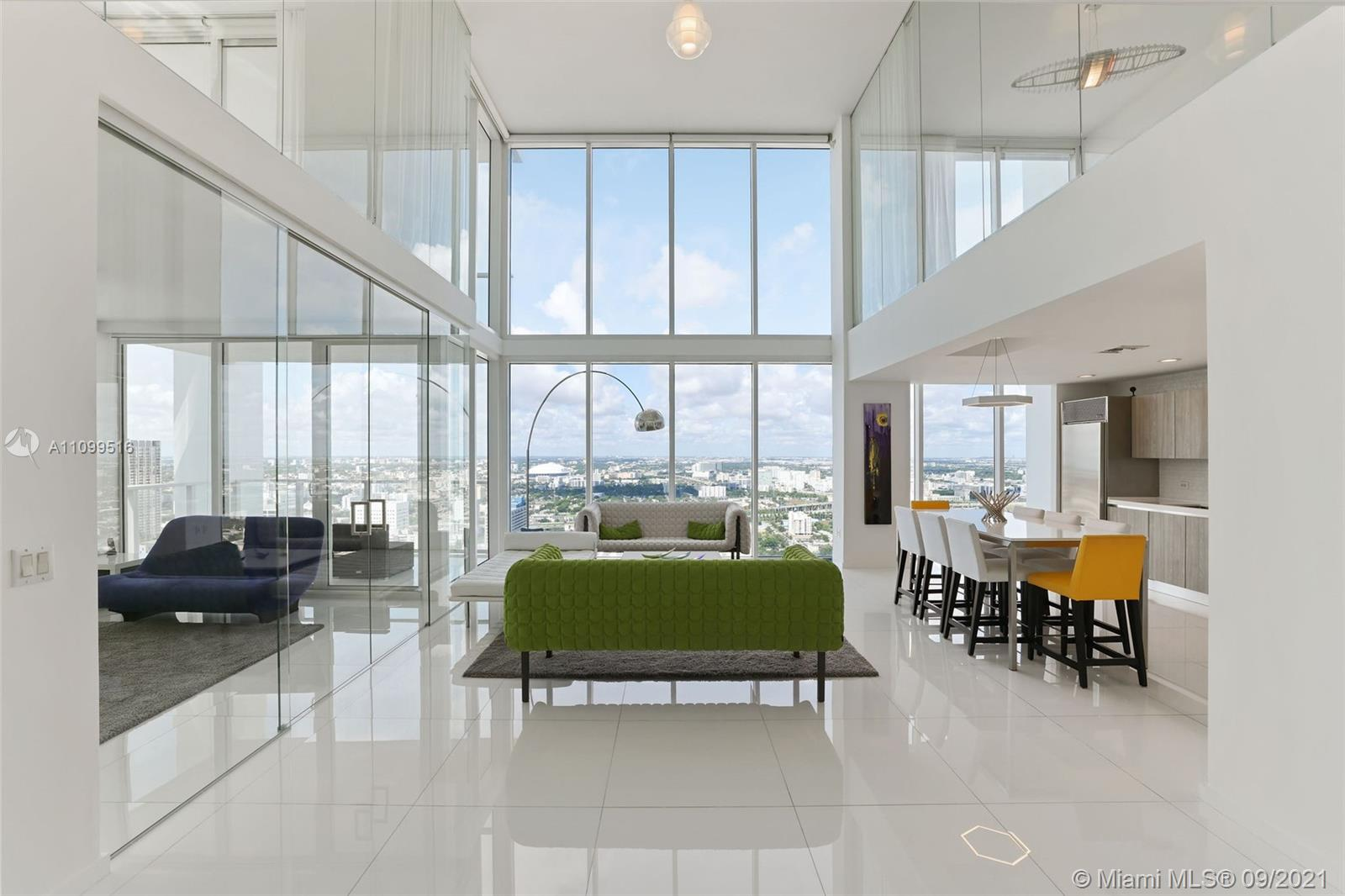 Welcome to one of the most spectacular tower suite lofts in the very boutique Ten Museum Park, located in the heart of Downtown Miami. No expense spared in this fully remodeled 3 BD 3 BA masterpiece in the sky. Brand new kitchen and bathrooms, new staircase, Glass enclosed Den into a 3rd bedroom, motorized window treatments, and so much more! Must see to appreciate all the natural light beaming through the 20 ft walls of glass. Unwind with a glass of wine into your very own dipping pool. Unmatched location with spectacular growth potential. Make this home in the sky yours before it's gone!