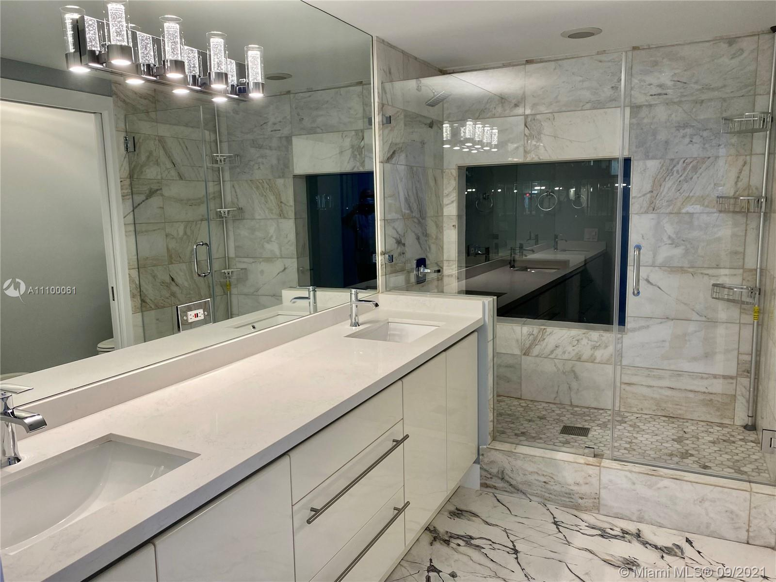 Brand new completely renovated rarely available 2 bedroom, 2 and a half bath Ritz Carlton Tower Residence home. Gorgeous new porcelain floors throughout, stunning bath renovations (completely new), top of the line new kitchen appliances, outfitted closets, new large size washer and dryer, new blinds in every room. Spectacular sunset views from large balcony overlooking pool, palm trees with view to skyline of Coconut Grove and Coral Gables. Enjoy two pools, gym, Ritz-Carlton services including room service.