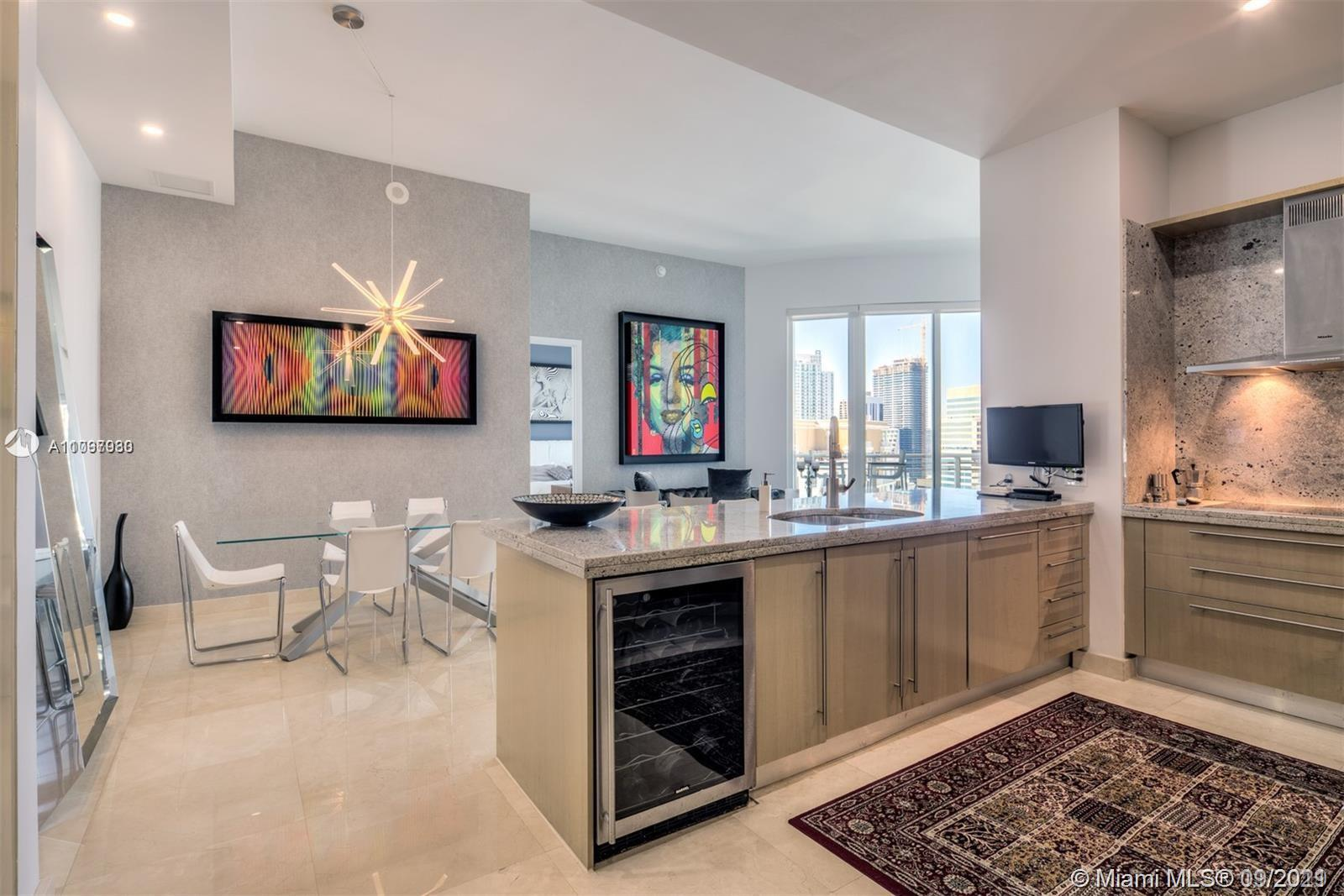 Beautiful unit in Asia Condo. 2/2 1/2 with marble floors, high ceilings, private elevator, elegant kitchen with beautiful views. Amenities include tennis, pool, gym, storage, party room, racquetball, jacuzzi, sauna and 24-hour valet.