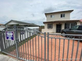 Gorgeous newly constructed gem that is centrally located in east Hialeah. This beautiful house has 5 bedrooms and 4 1/2 bathrooms. Out of the 5 bedrooms, 2 are master bedrooms, 1 located on each floor with 1 master bathroom in each master bedroom. Large kitchen with new appliances including Refrigerator, microwave, cooktop, dishwasher, and double oven. Combo washer and dryer unit included and conveniently installed downstairs. The location provides close and easy access to great schools, hospitals, expressway access, and restaurants. Ample parking area with enough space for several cars, as well as a large fenced backyard. Don't miss this rare rental opportunity