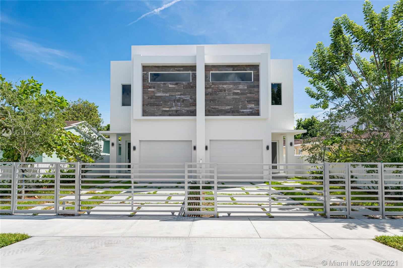 Modern New Construction Duplex/Townhouse in a prime location. The property features two open concept units. Each unit includes 3 bedrooms and 4 full baths, a car garage, and ceramic tile floors. The ample downstairs space invites to entertain; there is a living room, dining with an integrated kitchen, family room, and a full bath/cabana leading to the pool. The kitchen is fully equipped with Samsung Smart appliances, quartz countertops, and European cabinetry. Full bath/cabana. Sculptured ceilings with recessed led lights and speakers completes the first floor. Upstairs there are three well-sized en-suite bedrooms and a laundry room. The master bedroom features a walk-in closet and a master bath with an all marble, fully glass-enclosed shower with hydro jets, and a separate bathtub.