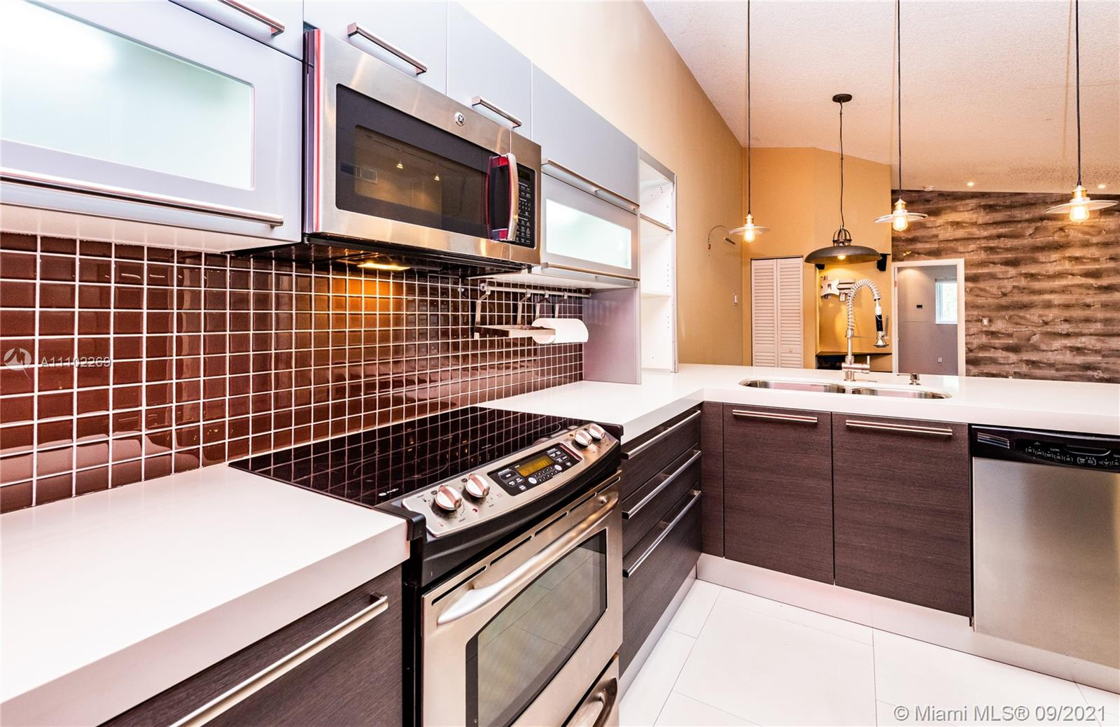 Completely remodeled unit in the heart of Doral, near restaurants, shops, A+ schools, Downtown Doral, CityPlace Doral, Turnpike, Palmetto, and Dolphin expressways. The unit features a Modern looking Kitchen with Stainless Steel Appliances, Quartz Countertops, Italian cabinets, Italian porcelain floors, and wine coolers. It has an enclosed balcony with a washer and dryer. Doral Place is located inside Doral Park which features resort-style amenities such as Tennis courts, Basketball courts, Beach Volleyball courts, Olympic Pools, Gym, Restaurant, Playgrounds, Sauna, and More. Membership to Doral Park Country Club is included. Pets are welcome. Showings will start on Monday the 27th of this month.
