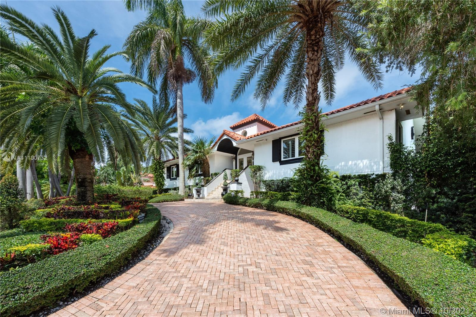 Elegant, two-story waterfront home with 5 bdrms/ 4½ baths (with bidets), heated pool. a 10-seat movie theater, and a 4-car garage. 4,642 adj. sq. ft. on a 12,600-ft waterfront lot (no access to Bay). A curved driveway leads to the front door. Lush landscaping. Foyer entry. Formal dining room to the right. Elevator. All white, newer kitchen with high-end appliances, pantry, and laundry closet overlooks the spacious Family room. Downstairs is an in-law suite with a full bath, billiard room, gym area, library/office, and storage. Outside find the covered entertainment patio with bar. Water cascades, a chickee hut, and the theater entrance. All of these are in gated Gables by the Sea. Excellent public and private schools nearby. Spectacular!