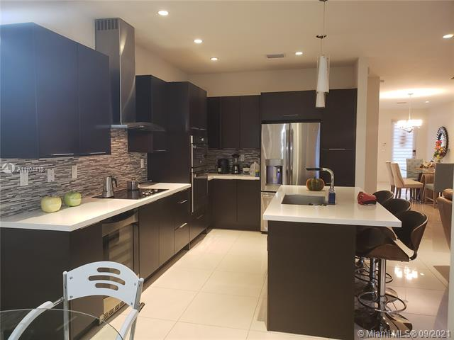 Excellent for investors. Spectacular towhome located in desirable Landmark community.  4 bedrooms 4.5 baths plus den. 3 open balconies. BBQ on the third floor. Low association fee.