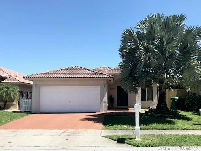 4/2 with 2 car garage SFH in quiet community, tile and wood laminate floors, SS appliances, vaulted ceilings, impact windows, crown moldings,  covered terrace, fenced yard, fruit trees, greenhouse for plants. Lakes and parks nearby for family activities. Close to shopping and Turnpike.