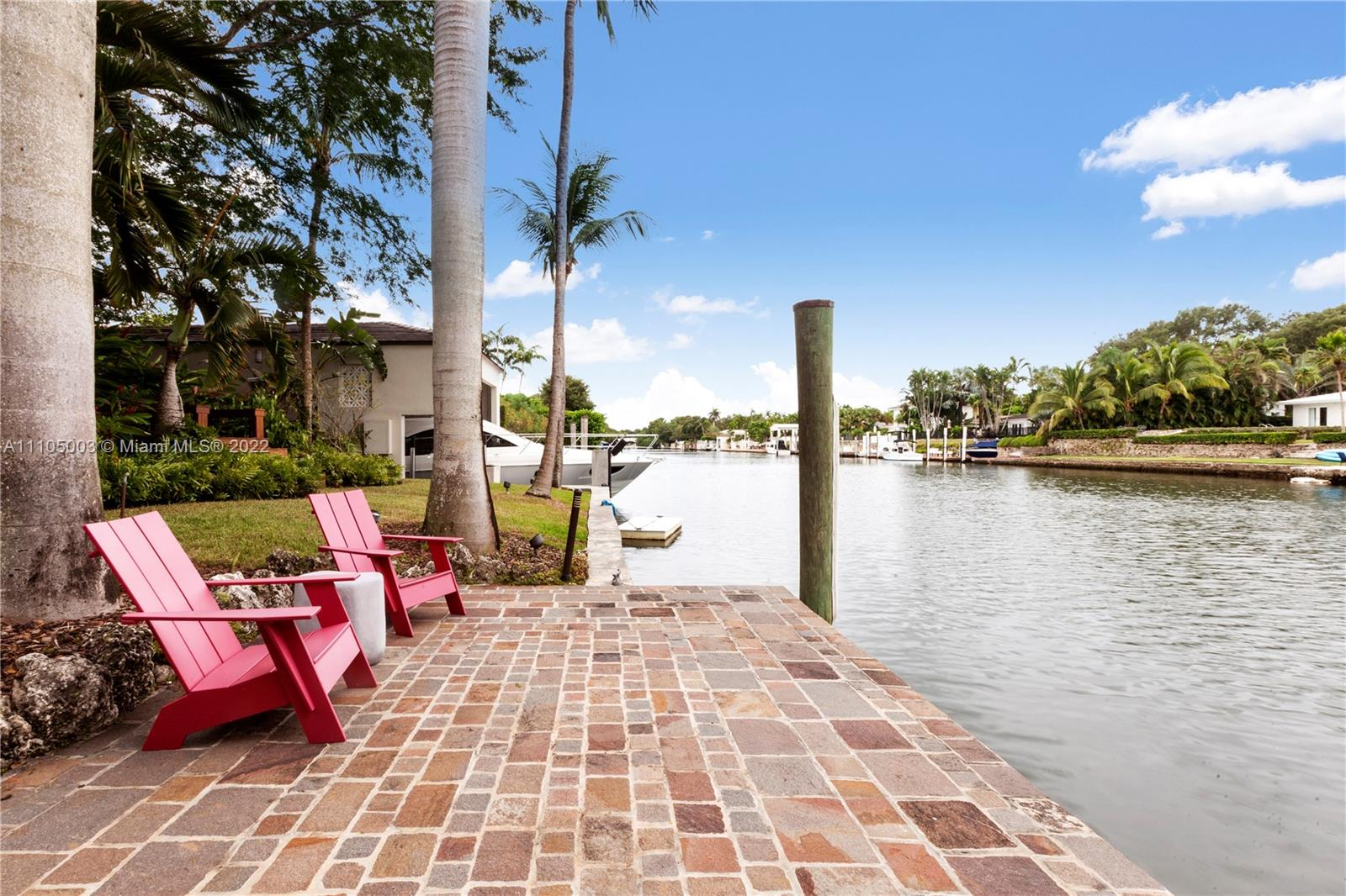 Extraordinary 137 ft. Waterfront family home in Coral Gables, perfect for boaters and water sport lovers, featuring a large Deck; Boat Slip and a unique Boathouse (aprox 500 sqft bonus area under AC media/gym room). This very spacious completely remodeled 5 BR 6.5BA and an office w/ private entrance is located on the widest part of the protected waterways east of US-1 on a gated 20,598 lot.  Meticulously designed to enjoy the incredible finishes throughout a very elegant floor plan. The abundance of light integrate both of the outside and inside living spaces. Close to shops, restaurants & top schools. Rare opportunity to own your private Resort and wake up every morning with gorgeous views of the water and lush gardens, and a chance to paddle boarding or jet skiing on your own backyard.