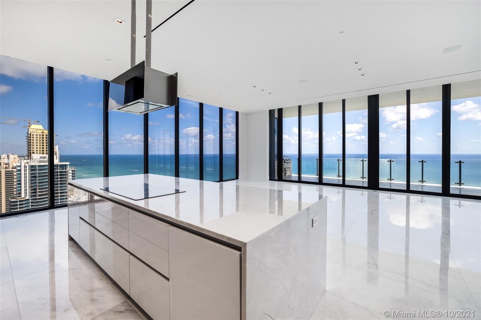 Enjoy unobstructed direct ocean views from this high floor corner residence in Muse Sunny Isles Beach. This never lived in 3bed/3.5 bath + den smart home has some of Sunny Isles best panoramic views. Muse is known for its sleek and modern design, with #3901 boasting interior features such as: a private foyer entry, 12' ceilings, book-matched Italian kitchen cabinetry, marble floors throughout, and an expansive living area. Exceptional principal suite w/midnight bar & spa-like bath. Expansive walk-in closet w/leather inserts & up lighting. Uniquely large outdoor terrace w/summer kitchen. Amenities include infinity edge pool, breakfast for owners, food/beverage service, house car, automated parking system, sauna & fitness center.
