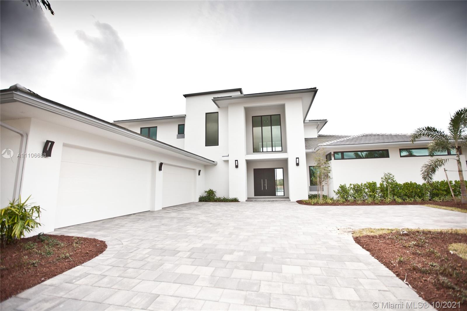 New custom home built in 2018, this beautiful home was built with family in mind, located in one of Weston's most sought-after communities. This elegant two-story canal-front estate features a beautiful open-plan kitchen with granite countertops, an oversized island, two sinks, fully stocked with top-of-the-line appliances, and a full butler's pantry. Master suite with private his and hers baths, walk-in closet and custom walk-in closets. Tile floors throughout. Large covered lanai, overlooking the pool and canal. Located on a 0.6467 acre lot, 4 car garage, 2 guest parking, hurricane impact glass, 7 bedrooms, 8 1/2 baths. All rooms include a private bathroom. 1 office and incredible infinity pool with heated SPA and incredible entertainment areas.