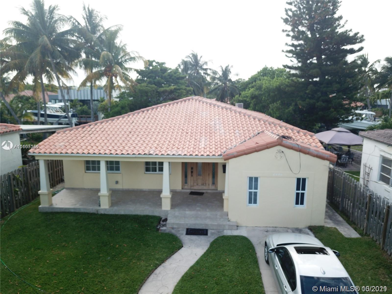 Beautiful remodeled oceanfront home made with great craftsmanship a few blocks from the beach. This 3 bed 3 bath is a hidden gem that overlooks the canal, and is minutes from the bay with no fixed bridges. This country feel home has that cozy feeling, perfect for relaxing in the clawfoot tub, or on the patio lying on a hammock enjoying the beautiful Miami weather. This house is not only for relaxing but also for enjoying family / friends around the updated kitchen with a deep cooper sink with granite cabinets and a large island that gives pleasure to entertain. On a large lot with plenty of driveway parking for you and your guest. Call for showings.