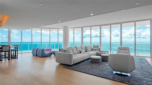 Rarely available and most coveted combination of 2 units with direct ocean views. A private foyer with direct elevator access leads into this spacious flow-thru floor plan consisting of 5 bedrooms 4 full baths and a media room, spanning 4378 sq.ft. of living space and a wrap around balcony, light Oak floors, chef's kitchen with cooking island, double ovens, double dishwashers and pantry closet perfect for entertaining and large families. Continuum offers 13 acres of luxurious resort amenities such as 1000 FT of white sandy beach, full service beach/pool club, 2 lagoon shaped pools, restaurant/bar, 3 tennis courts with Pro-Shop. Gym/spa, lap pool, security, valet and concierge.