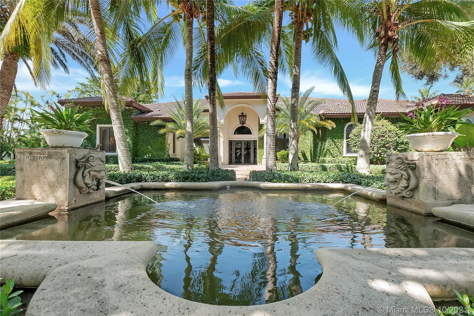 Prominent gated residence on palm-lined street in north Pinecrest. One-story estate features soaring ceilings & great distribution of space. Manicured backyard is a SoFL oasis with luxe pool/spa area, summer kitchen, koi pond, grassy area for playing & mature privacy trees. Dine-in chef's kitchen for entertaining opens to breakfast nook & large family room.  Enjoy covered al fresco dining and your summer kitchen. Elegant pool and decking invite you outside.  Huge master w/sitting room. Top-line finishes and features include impact windows/doors, whole-house generator, new garage doors, new lighting system, new closets, repainted on the interior, new exterior cameras, new A/C units & new washer/dryer/dishwasher. Top-rated Pinecrest Elementary school district and easy access to shops & US-1.