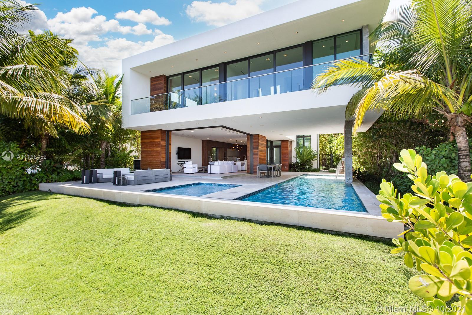 Welcome home to your very own furnished tropical waterfront estate. Located on prestigious Hibiscus Island with a 24/7 guard gate. Your private masterpiece offers wide bay views as well as views of Downtown Miami and Brickell, which provide for breathtaking sunsets. This home was masterfully designed in 2017 by award-winning architect Choeff Levy Fischman. The indoor/outdoor living is perfect for entertaining with its open dining and family areas. Featuring custom Italian kitchen, oak wood floors, brand new state of the art Crestron system, floor to ceiling windows and a 2 car garage. Step outside to your own resort style oasis including a salt water pool and spa as well as your own private dock. This is a must see!