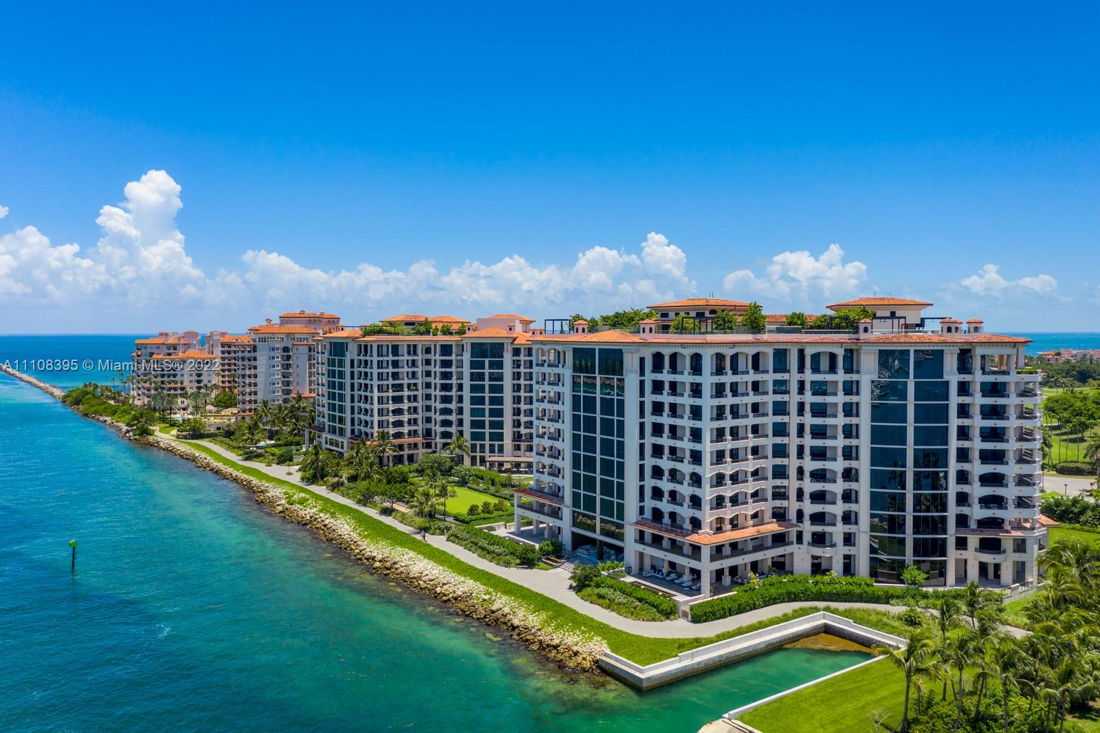 East facing, 3 bedroom, 3.5 bath with sparkling ocean views from Fisher Island's newest and most desirable building, Palazzo della Luna. This flow-thru unit, with East to West facing balconies, has 10-foot floor to ceiling windows. A ready, turn-key haven is professionally designed and furnished, with built-in closets throughout. The custom, craned-in, 16-foot white Statuary Marble countertop is a focal point in design in the Boffi gourmet kitchen. Miele, SubZero Refrigeration, and Wine Cooler round out the utmost in luxury and modern living. 6835 comes with the largest available storage room, two prime parking spaces outfitted with Tesla Charging stations, and 2 Garia golf carts. PdL is a full-service building with countless brand-new, amenities not found anywhere else on the island.