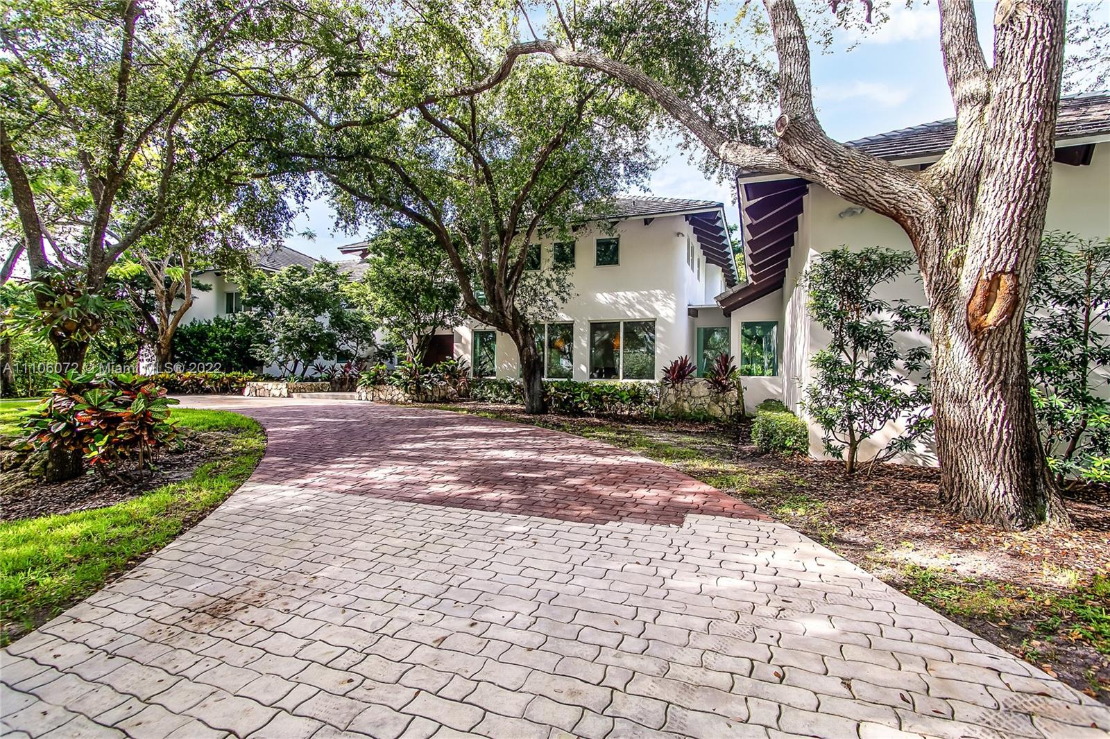 Open Wed 2 to 4 .This stunning estate is located in the coveted Pinecrest neighborhood. The home sits on aprox 39000sq ft  lot, on a quiet street, ideal for the privacy seeking homeowner. Featuring 6 beds + office/den and 7.5 baths, distributed through aprox 7200+ sq. ft., with natural light and soaring beamed ceilings throughout. Spacious living areas, gourmet kitchen with top appliances, 2 fireplaces, 3 car garage add to the understated elegance of the property. Amenities include, large heated pool, large backyard with lush landscaping and majestic trees, veranda with a summer kitchen, full-house generator, outdoor shower/pet-grooming area, basketball court and more. 3+ areas ideal for work-from-home. Top-rated schools nearby. Walk to Gulliver.  Quintessential South Florida luxury iving
