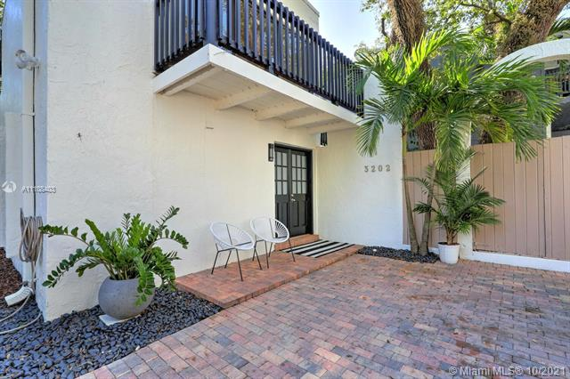 Quintessential Coconut Grove townhome. Free-standing residence in a quiet gated community of just 4 homes that share a courtyard & large pool. Prime location, just a short walk or bike ride to the village center's galleries, boutiques, cafes and bayfront parks & marinas. Light-filled living spaces open to private outdoor balconies, new composite wood deck & brick terraces surrounded by tropical landscaping - canopied by mature oaks. Ideal floorplan includes 2BR's w/en-suite baths. Master has walk-in closet. 1st level living/dining/powder room & kitchen w/wood cabinetry, granite countertops & breakfast bar. In unit washer/dryer. Gated parking for 2 cars. Located in the highly rated Coconut Grove Elementary school district. Just minutes to downtown, MIA, Key Biscayne & the Beaches.