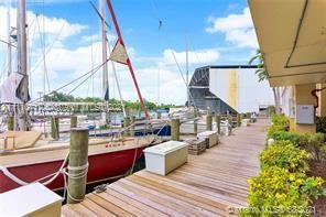Waterfront opportunity. Dock available. River Run Condominium offers 24/7 security, guard gated. Excellent location, minutes from MIA and Beaches. Third floor unit in excellent conditions. Nothing is original. Newer kitchen and bathrooms. Split bedroom plan. 2 good size bedrooms. Master with walk in closet. Washer and dryer in unit. Crown moldings. All tile floors in all the living areas and Berber carpeting in the bedrooms. Miami living, see it like a native. Ready for showings.
