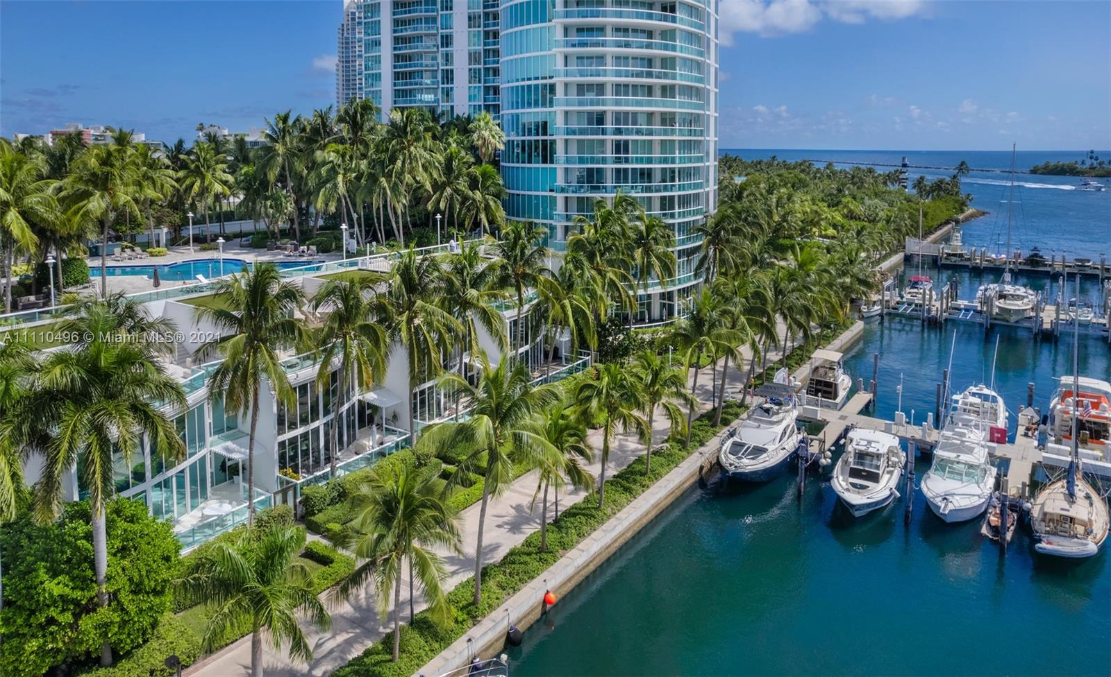 Own this unique Waterfront townhome located South of Fifth, Miami Beach's most prestigious residential address. A 3 BR/4.5 BA marina townhouse that lives like a home, with the easy maintenance & amenities of a condo. Dramatic 20-ft ceiling entry, gorgeous water views, private 2 car attached garage & tons of storage. A few steps to the Miami Beach Marina, Dock your boat right outside your front door! ENTERTAIN IN STYLE on 1,500 SF of sun-drenched & rooftop terraces. Swimmers, walk up your personal stairs to Murano's lap pool. Dog Owners, enjoy easy access to your front yard. Take in Marina Life, Downtown Views & Stunning Sunsets. Live steps from the beach & 17-acre South Pointe Park. Walk to 15+ world-class restaurants including Carbone, Milos & Prime. This waterfront townhouse has it all!