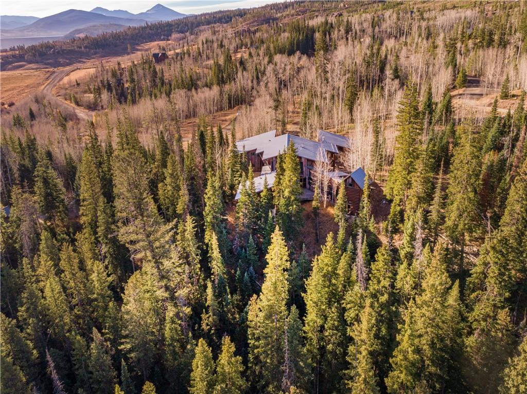 Private setting nestled in a mature spruce forest. Home backs to Willow Creek and trail system to wilderness terrain. Designed by Harry Teague of Aspen, multiple wings offer privacy along with generous gathering areas.