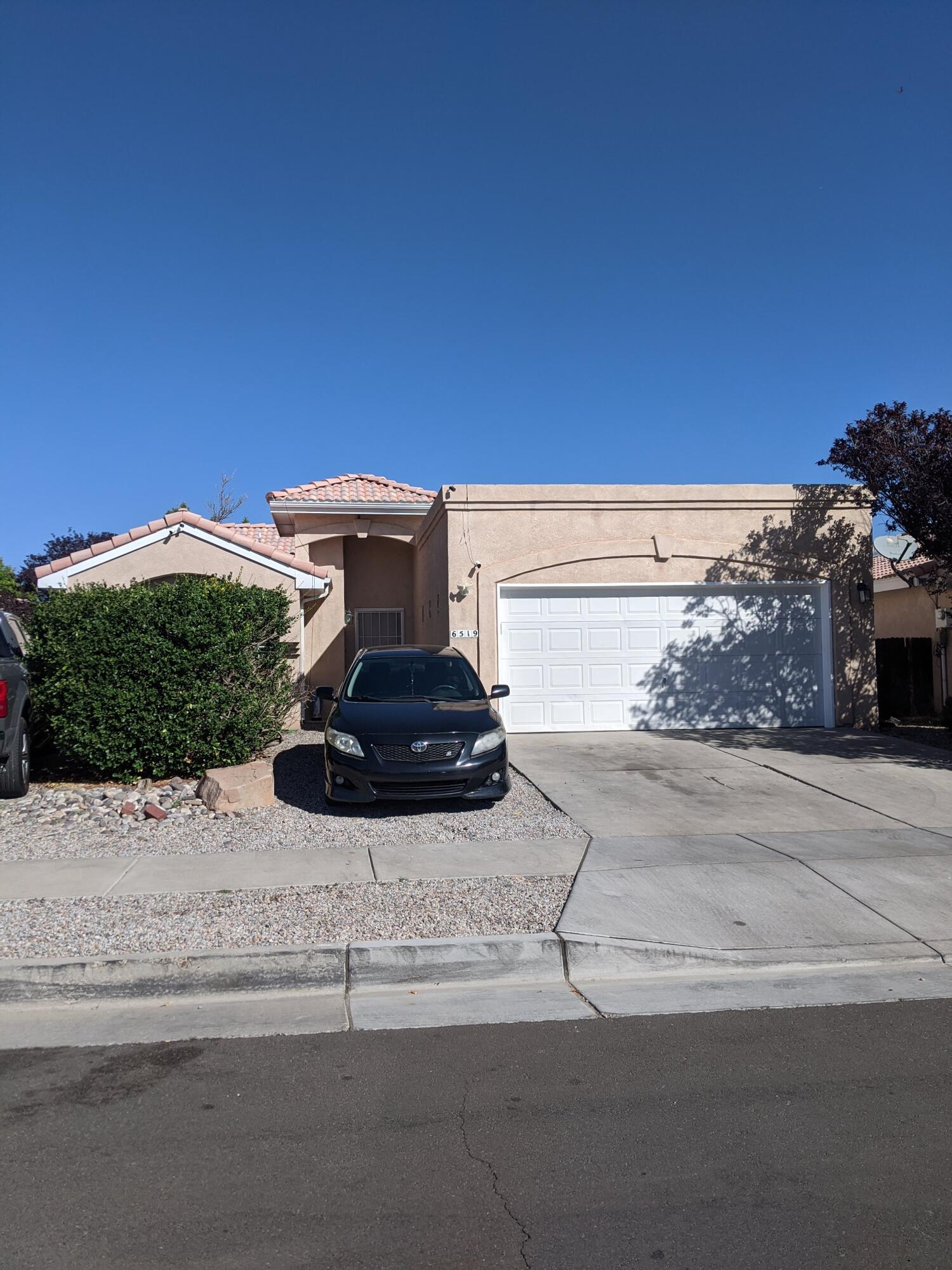 Light and Bright with Vaulted Ceilings, Glass Block Windows and Skylights! Kitchen has an Island and pass through with countertop to living room. Master with double sinks and walk in closet. Beautiful Tile Roof in Great Neighborhood!