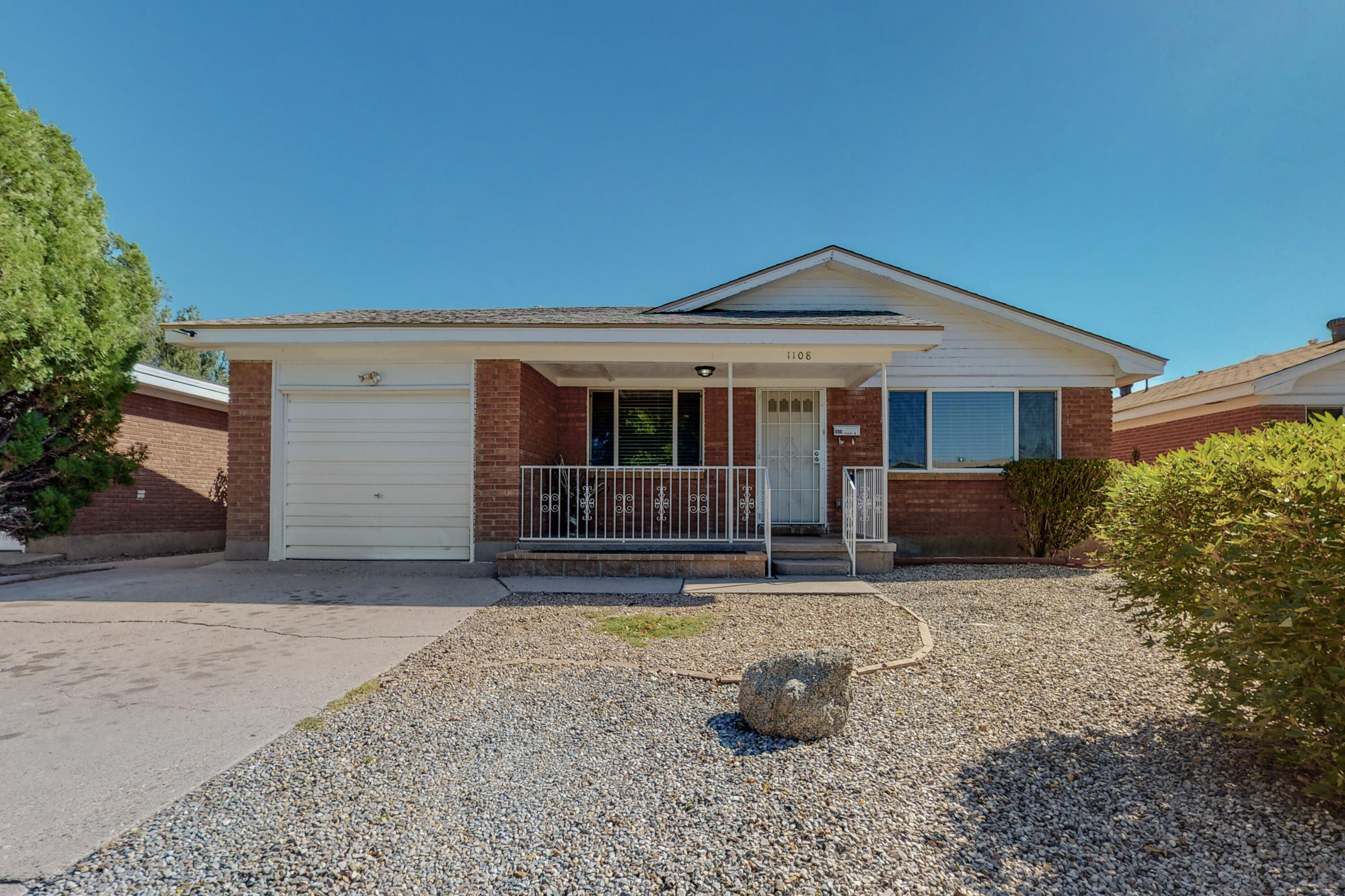 Welcome to this GEM of a home. Located minutes to Kirtland AFB and Sandia Labs . Convenient access to I-25, schools, restaurants & shopping. Open floor plan, flooded with natural light. 2 living areas, 3 bedrooms with a possible 4/flex room. Kitchen features granite countertops, solid wood cabinets and all kitchen appliances stay! Oversized laundry room. Refinished hardwood floors, thermal windows,  Roof approximately 5 years old. Mature private backyard, grass, trees and a covered patio. 1 car garage.