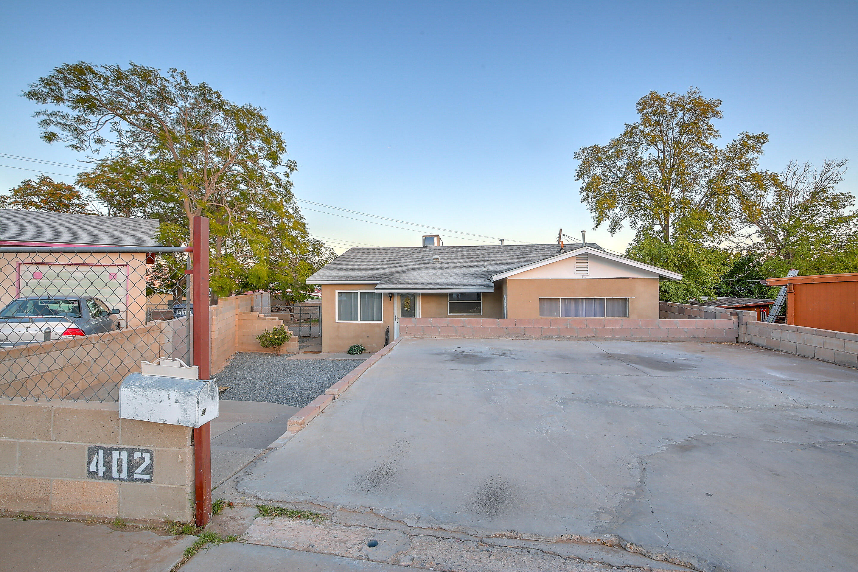 GREAT-LOOKING 3 bedroom in an established south valley neighborhood ready for you to move right on in!  This one comes with an extra room you can make into a guest bedroom, a home office or a home gym--you choose! The open living and dining area features beautiful wood flooring, ceiling fans and a slider to the backyard. Cute kitchen with views to the outdoors and to the living area so the chef can keep an eye on the gourmet dinner and all the happenings.  Beautiful accent paint throughout with a combination of carpet and wood flooring.  Extra large backyard with a covered patio and walled in for privacy. A cement pad has been added for extra parking in the front large enough for trailer or RV parking. This one is close to the interstate, shopping and all the things you need!  Come see it!