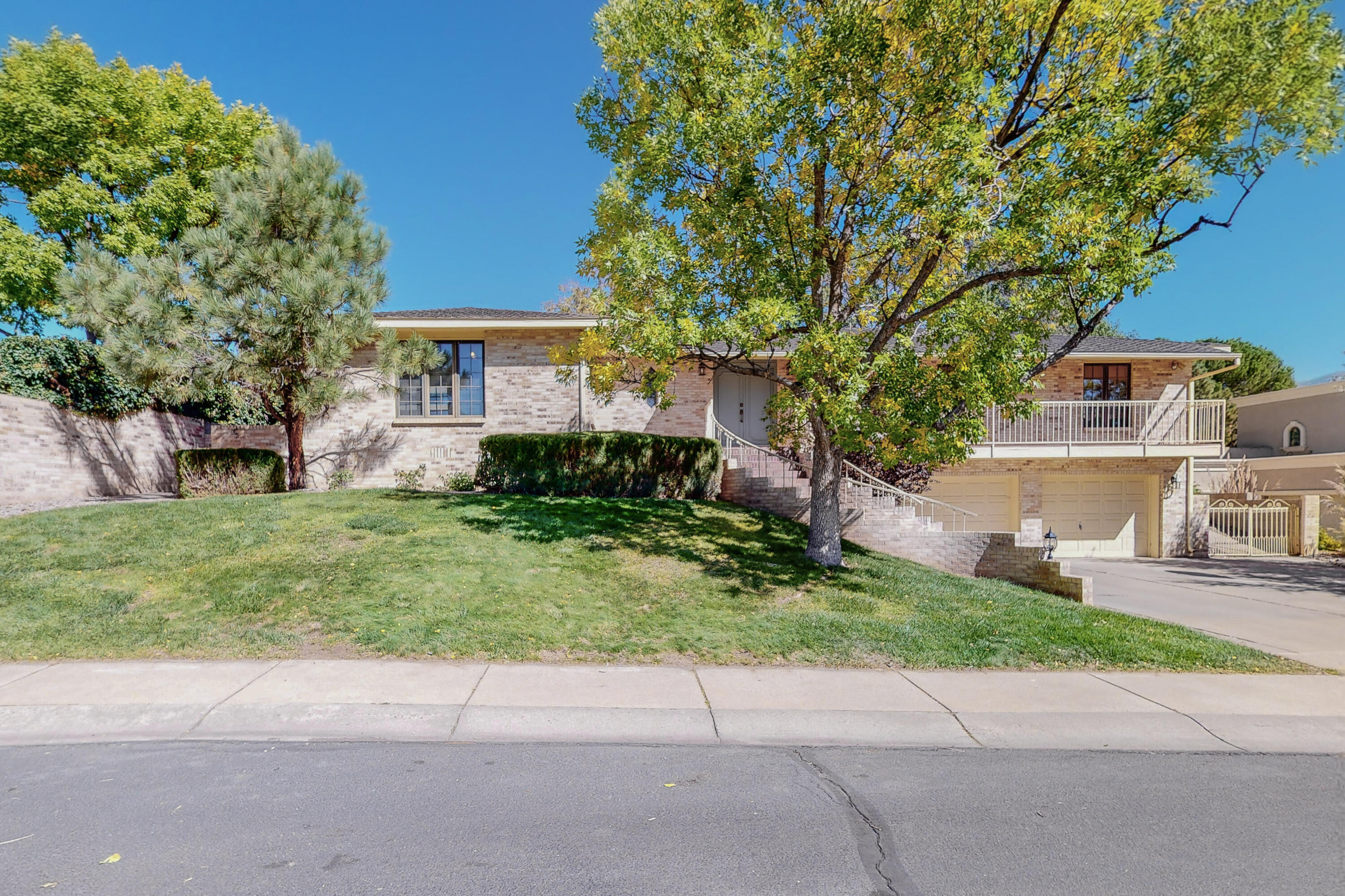 Looking for a great home in a gated , neighborhood?   Come this well kept 3329 sf home , 5 bedroom, 3 bath, two level home on a large .25 acre lot in the Tanoan neighborhood with REAL people at gate 24/7.  House has 3 living areas including formal LR/DR & family room on the main level plus bedroom, den/ exercise room & 3/4 bath on the lower level. Great separation of space for guests or family members.  Updated stainless steel appliances in kitchen. All 3 baths recently remodeled. Huge covered porch  overlooking a grassy lawn & mature trees works well for shaded entertaining or relaxation. Quiet location on a  cul de sac. Golf, pool, tennis & dining close by at optional country club.  OPEN HOUSE Sun 10/24 1:00-3:00.