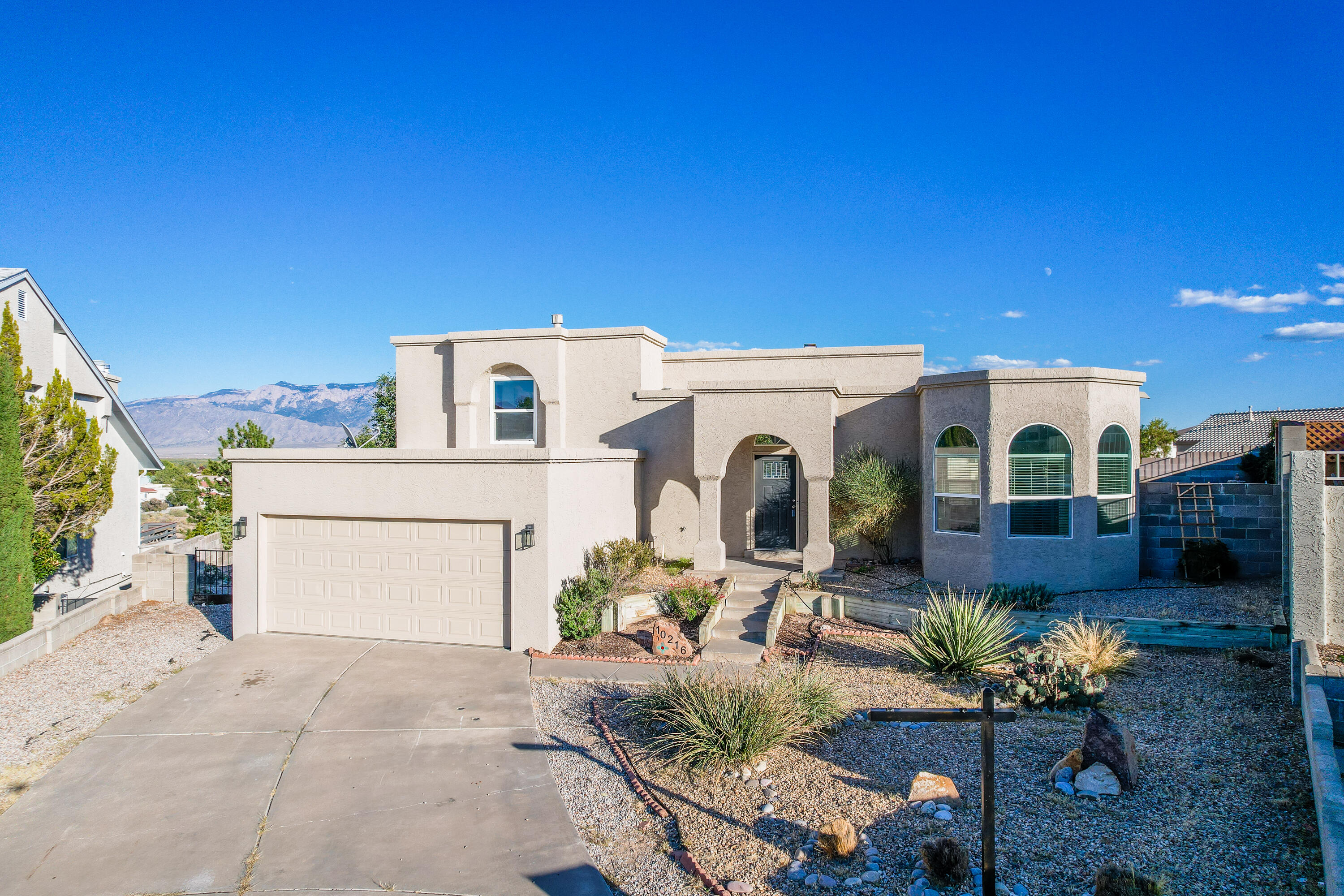 This Open has Neighborhood Access to Open Spaces and Trails. A Completely updated space that is Move-In ready. Three Bedrooms, and an office or possibly a recreation room. With Soaring ceilings, a fireplace, this Floorplan is a must see to appreciate how livable the space is. The lot is located in a Large Cul-De-sac with views of the Sandia Mountains from the deck of the Owners Suite.
