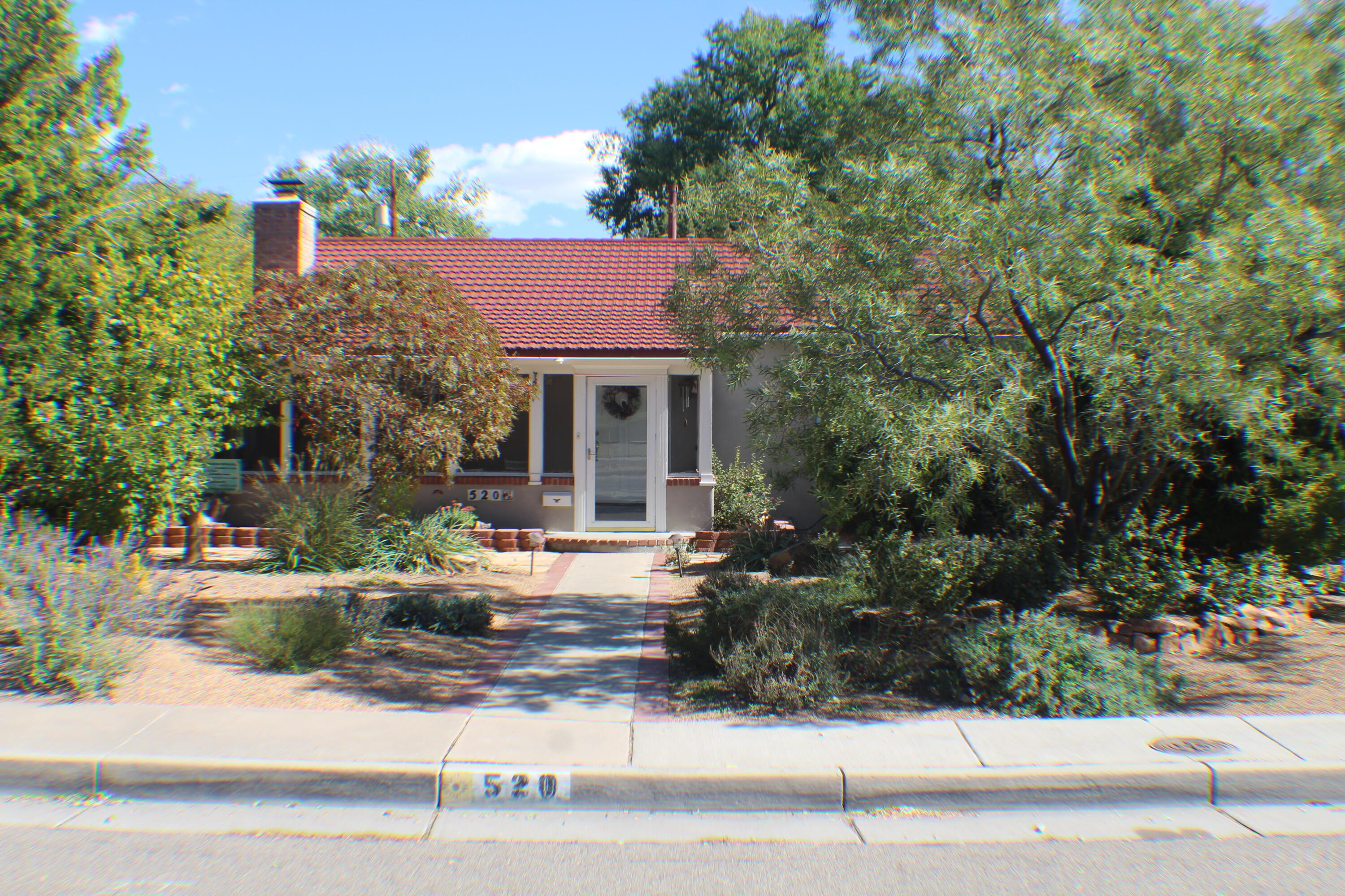 Fabulous home across the street from Albuquerque Country Club. Hardwood floors in beautiful condition. Two refrigerated air conditioning units and two furnaces. Many lovely spaces to relax in. Front porch, enclosed patio, living room & family room. Very private backyard with goldfish pond and and gazebo.