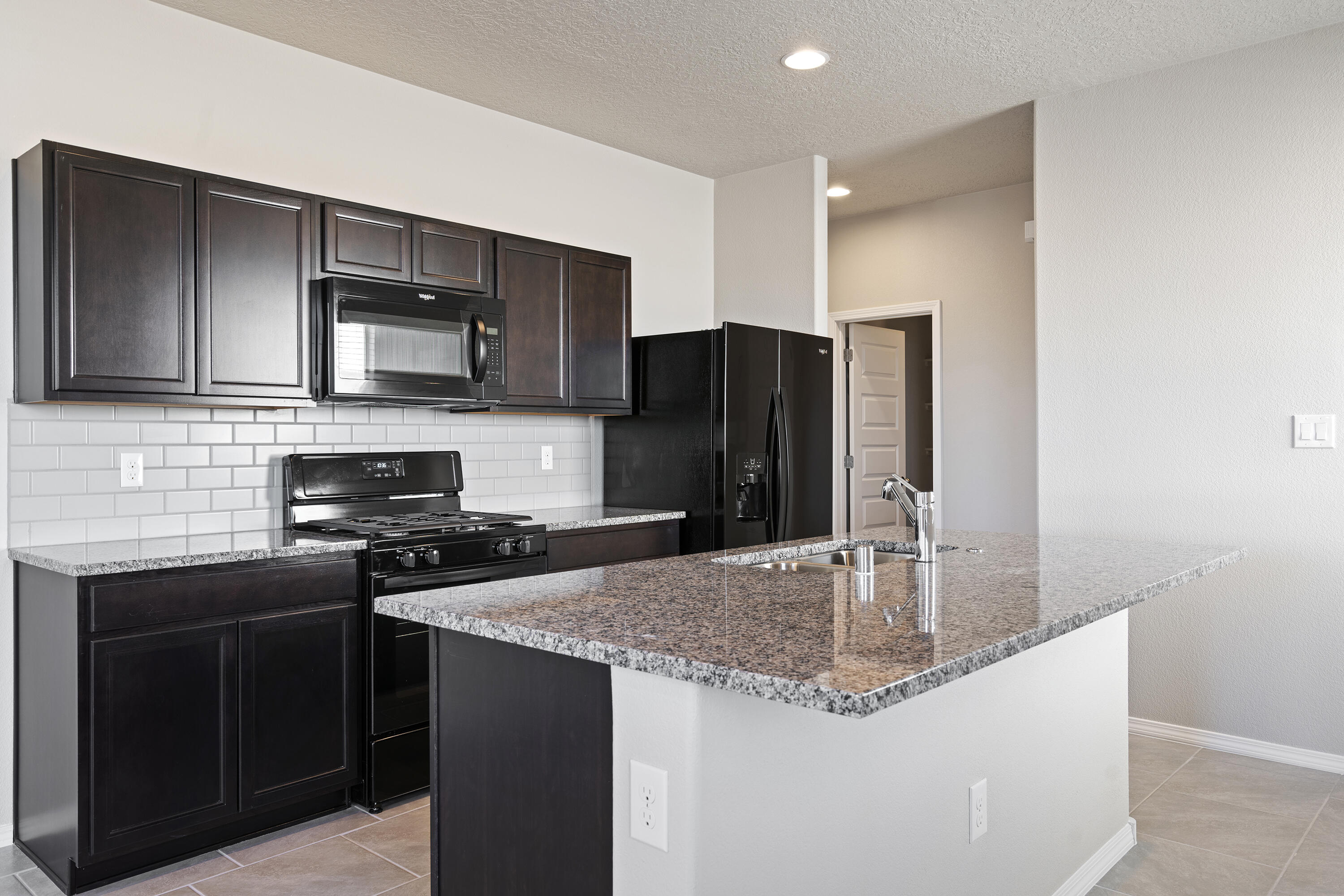 The Sierra plan is one of our brand new floorplans that we are offering here in Los Diamantes! This three bedroom two bath home is loaded with energy saving features as well as features that most builders consider to be upgrades like granite counter tops, tile flooring in the wet areas and 9 ft. ceilings. Unbeatable location with endless possibilities!