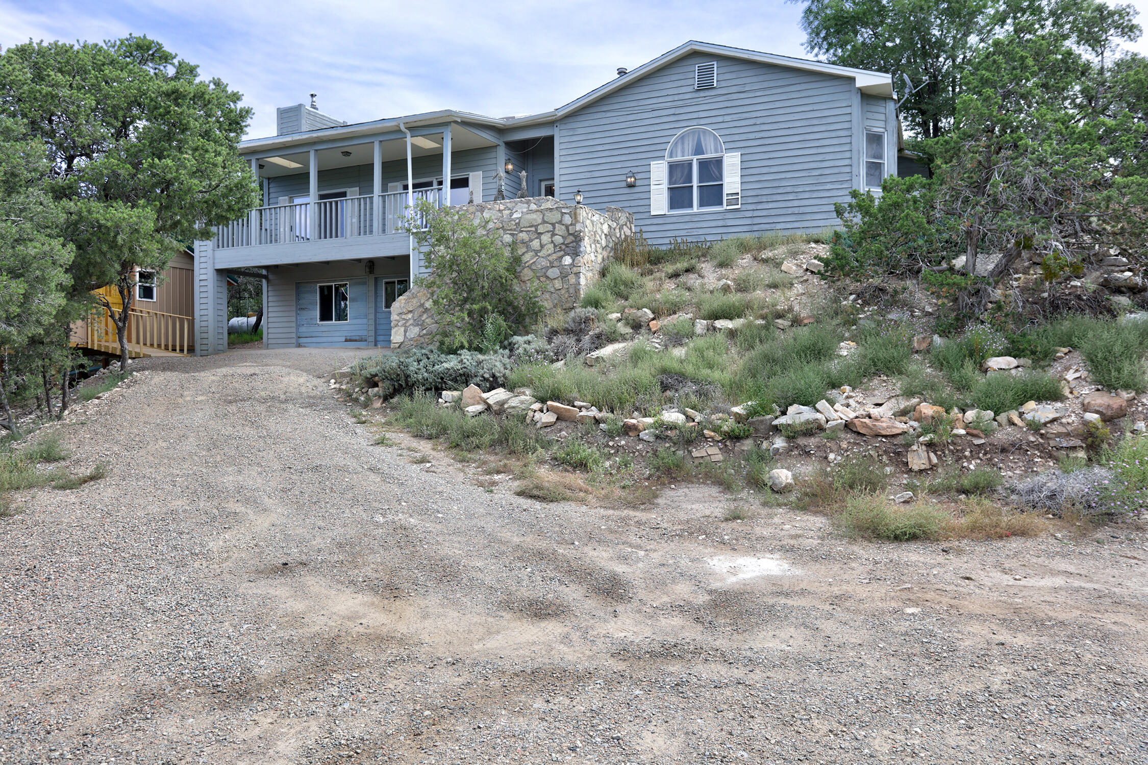 PRICE REDUCED!! - This 3 bedroom, 2 bathroom home is situated perfectly on 1.38 acres to take full advantage of the mountain views. The beauty of the mountain is impossible to miss with double sliding glass doors in the living room, opening up onto a large deck. There is an in-floor hot tub with floor to ceiling windows so you can bask in the beauty of the mountain. Newer pellet stoves are an excellent heat source in winter in addition to the base board heating and central forced air. You'll find plenty of room for all your extras in the new (2021) auxiliary building. Former garage has been partially converted so it is a 750+ sq/ft bonus with a pellet stove already installed for heat. Well and septic were installed in 2018.