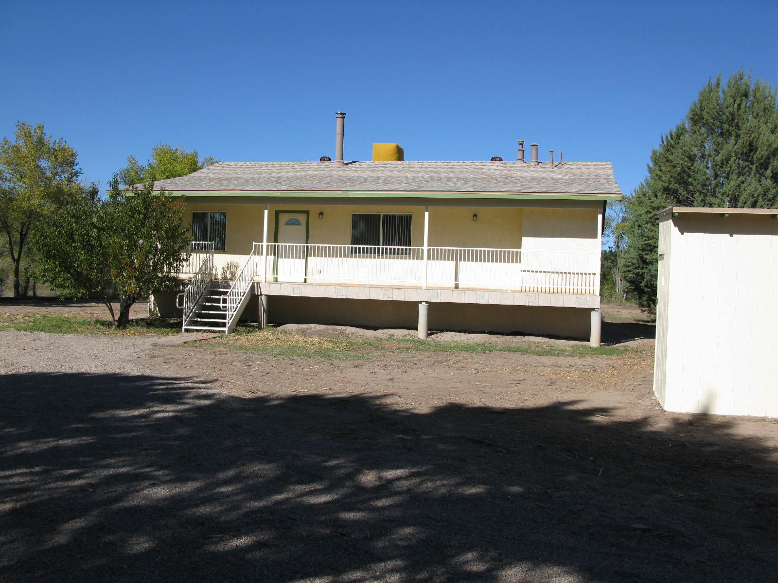 A very sharp looking recently updated house roof < 1 year old, New flooring  and paintCome and show it will sell itself.  Located on 2 irrigated acres.  Pump House and a 8' X 28' storage unit