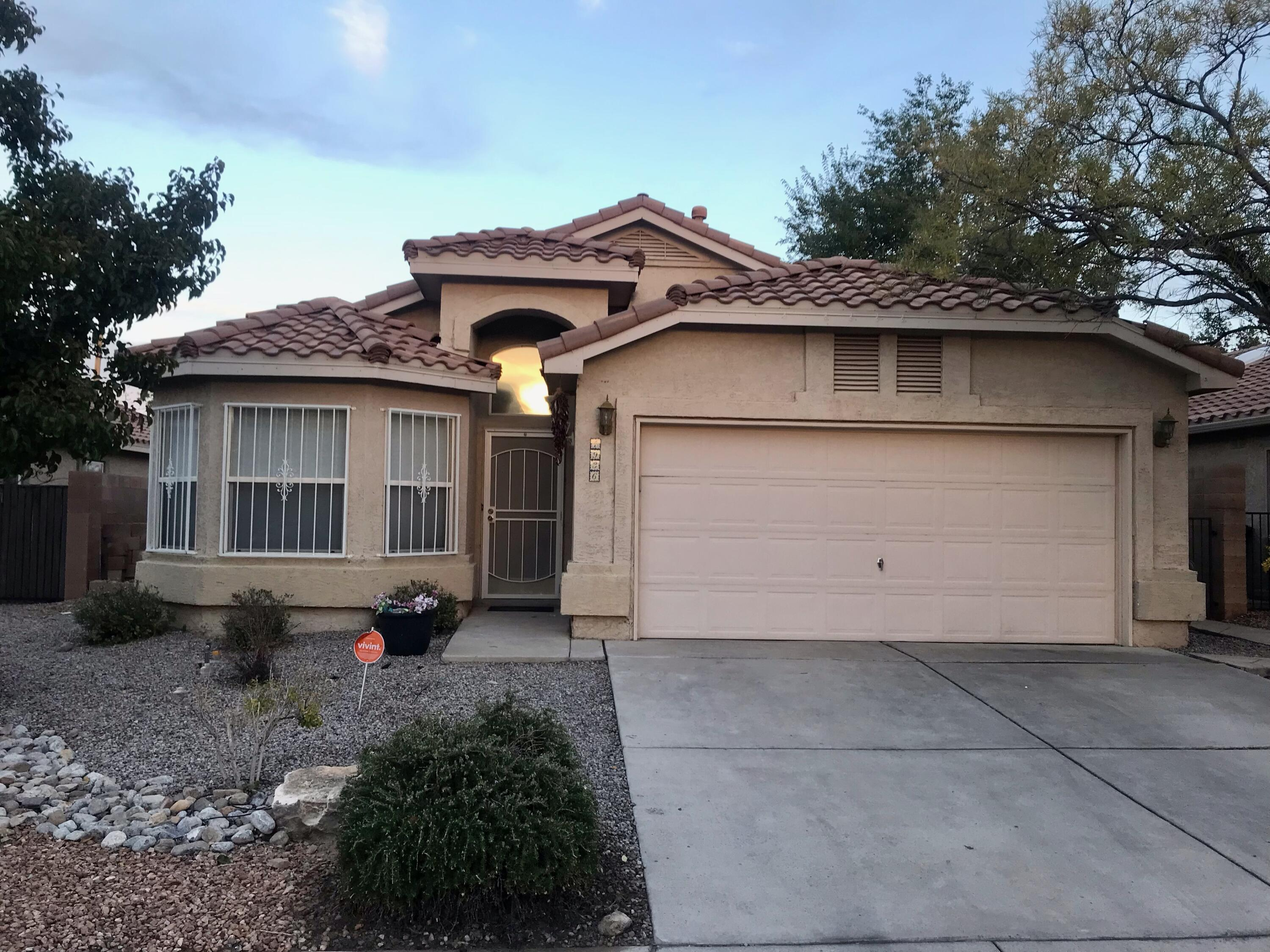 Wow! Come see this special find in the popular Story Rock subdivision.  The home features two living areas plus a formal & family dining areas. Very flexible floor plan if formals are not needed.  Think game room, family room, office or other.  Very nice kitchen with granite tops, tile flooring & walk-in Pantry.  The large den/family room offers a cozy fireplace and built-in TV shelf. You can also step out to the large back patio & backyard and enjoy Sandia Mountain views!  The spacious Master bedroom has a big walk-in closet, full bath & backyard access. Two more big bedrooms & another full bath are down the hall. The laundry room steps out to the big 2 car garage.  Enjoy the landscaped yard and the private and lush Story Rock park! Easy access to Unser/Coors and river crossings.