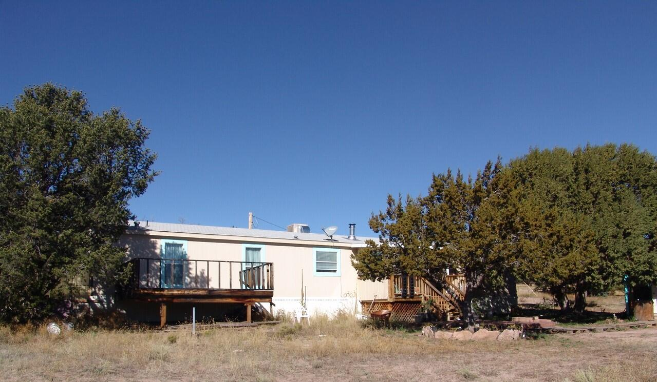 Located approximately 4 miles southwest of Datil, NM, this property contains 1.02 acres in the Homestead Subdivision. Improvements include a furnished 1,280 sq. ft. manufactured home with 3 bedrooms and 2 baths and four storage buildings. There is an enclosed room built on in the back and decking in the front of the house. Upgrades include beautiful Spanish tile flooring and a stove pipe area ready for a wood burning stove. Although the flooring is not completely finished, all materials are included with the sale. Heating is provided by central forced air.  High speed internet is available through DSL. The terrain is varied with mature tree coverage providing plenty of seclusion. The property is near the Cibola National Forest providing the opportunity of hunting, hiking and trail riding.